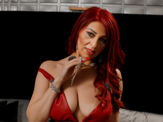 I'm A Camwhoring Desirable Female And At LiveJasmin I'm Named RedHeadSwitchy And My Age Is 40 Yrs Old